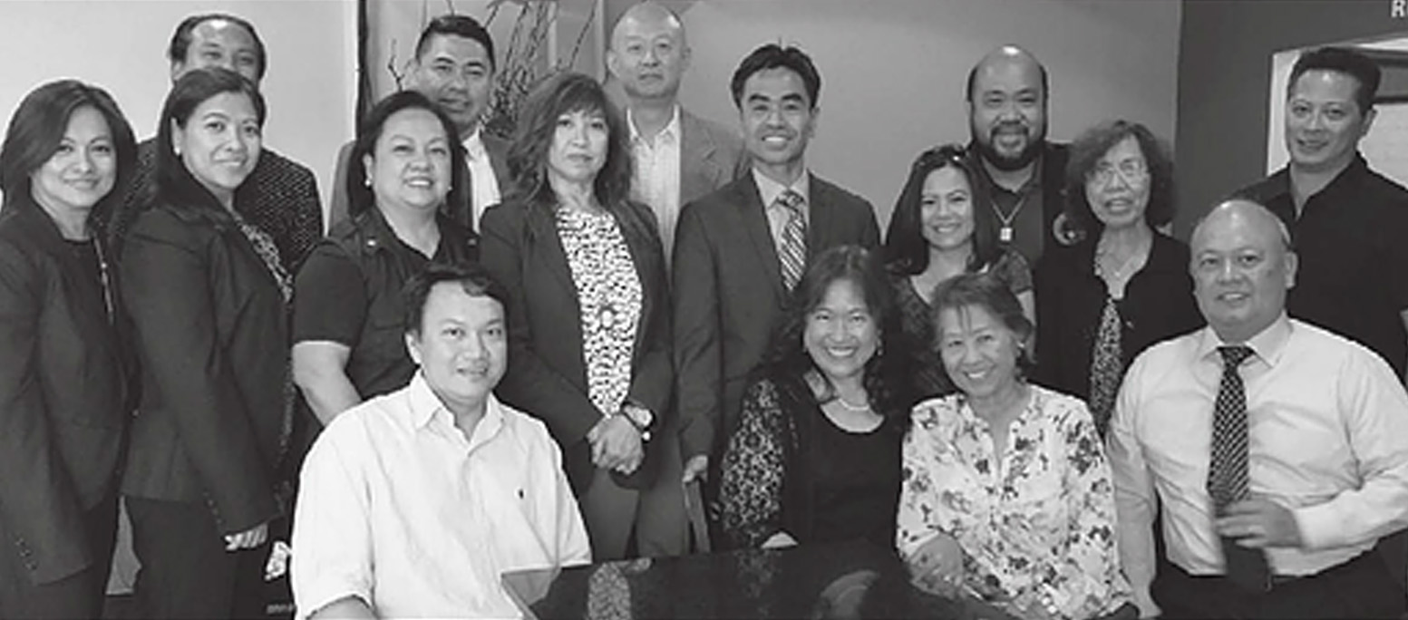 Mayor Pro Tem James Toma, standing 5th from left, engages Filipino Americans.