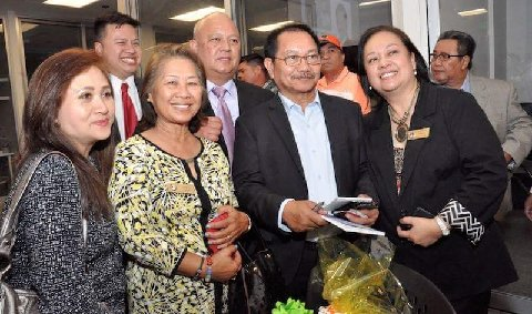 With FACCTC adviser Mary Ann Omega, rightmost, and Sec. Manny.